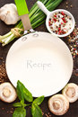 White frying pan with copy space for note or recipe surrounded by food ingredients Royalty Free Stock Photo