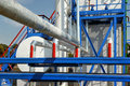 White fuel tanks and color gas pipes Royalty Free Stock Photo