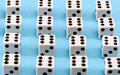 White gamble dice black dots on blue background Stock Images