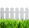 White garden fence and green grass isolated on background Stock Photo