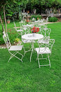 White garden furniture in beautiful garden. Royalty Free Stock Photo