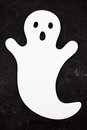 White ghost on black background felt a halloween decoration Stock Photography