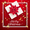 White gift box with a beautiful red bow. Merry Christmas and Happy New Year greeting card. Vintage Background With Royalty Free Stock Photo