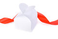 White gift box with a clasp in the form of heart and red ribbon Stock Photos