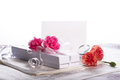 White gift box with flowers carnation high key background Royalty Free Stock Photography