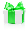 White gift box with green bow isolated on the white background Royalty Free Stock Photography
