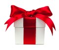 White gift box with red bow and ribbon over white Royalty Free Stock Photo