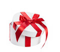 White gift box with red ribbon Royalty Free Stock Photos