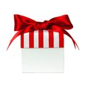 White gift box with red striped lid isolated bow and on Royalty Free Stock Photo
