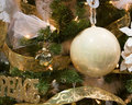 White and Gold Christmas Tree Ornaments Royalty Free Stock Photography