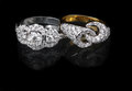 White gold and golden diamond rings ring ring on black background Stock Images