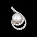 White gold pendant with pearl on black background Stock Photo