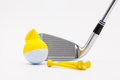 White golf ball with funny cap and golf club on the white backgr Royalty Free Stock Photo