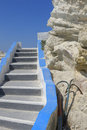 White greek stone steps closeup of blue and next to rocks with blue sky background greece Royalty Free Stock Photos