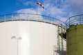 White and green oil tanks diesel of a refinery under a blue sky Royalty Free Stock Photography