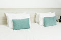 White and green pillows on bed for any use Royalty Free Stock Images
