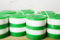 White and green striped cylindrical handmade candles Royalty Free Stock Photo
