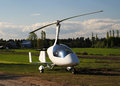 White gyroplane parked on the private airfield in sunny day Royalty Free Stock Photos