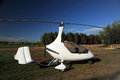 White gyroplane parked on the private airfield in sunny day Stock Photos