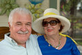 White hair senior man and his wife posing men in straw hat relaxed Royalty Free Stock Photos