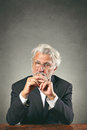 White hairs man with sharp gaze boss and leadership concept Stock Photos