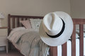 White hat on bedpost panama bed post subtle colours Royalty Free Stock Image
