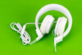 White headphone on green background Royalty Free Stock Photo