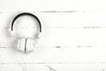 White headphones with wire on white background