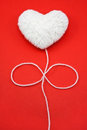 White heart shape made from wool Stock Image