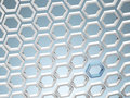 White honey combs whith blue hexagon Royalty Free Stock Images