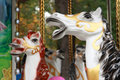 White horses childrens carousel holidays Stock Photos