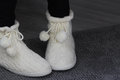 White house boots lovely slippers for winter time Royalty Free Stock Images