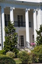 White house a colonial style home with a well manicured yard Royalty Free Stock Images