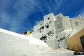 White house on santorini island and clouds Royalty Free Stock Photo