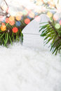 White house toy in the snow and fir tree christmas postcard with sopy space for greetings Stock Photos
