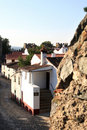 White houses within the ancient walls of fortress Stock Images