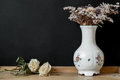 White Hungarian Herend porcelain vase with dry flowers Royalty Free Stock Photo
