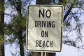 White information sign no driving on beach Stock Images