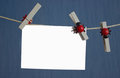 White isolated photo fixed clothespins on rope Royalty Free Stock Photo