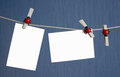 White isolated photos fixed clothespins on rope Royalty Free Stock Photo