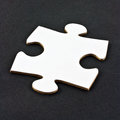 White jigsaw piece closeup of plain on dark background Stock Image