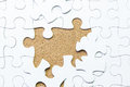White jigsaw puzzle background mount in cork board Stock Photos