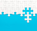 White jigsaw puzzle on blue background Royalty Free Stock Photo