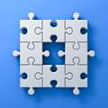 White jigsaw puzzle pieces one missing concept on blue wall background with shadow 3D render Royalty Free Stock Photo