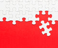White jigsaw puzzle on red background Royalty Free Stock Photo
