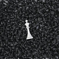White king on a sea of pawns Royalty Free Stock Photos