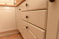 White kitchen cabinets and drawers grooved arched Royalty Free Stock Photos