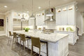 Photo : White kitchen design in new luxurious home  textile in