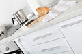 White kitchen detail - with cutting kitchen board, bread, fabric Royalty Free Stock Photo