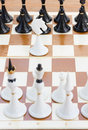 White knight in front of black chess single Stock Image